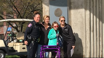 8-year-old with juvenile ALS becomes an 'Officer For A Day' in Grand Rapids