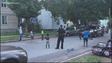 GRPD officers play basketball with local kids