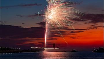 Grand Haven catwalk lights turned on during beach celebration