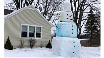Giant snowman brings Coopersville neighborhood winter joy