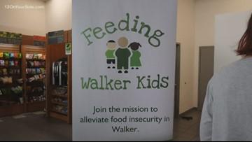 Volunteers help pack snacks for Walker kids in need