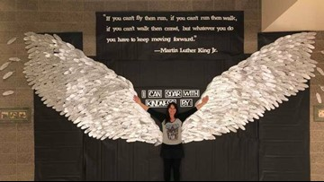 Local elementary students make wings out of 700 feathers to honor MLK