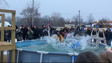 Local waterproofing company gets wet for Special Olympics' Polar Plunge