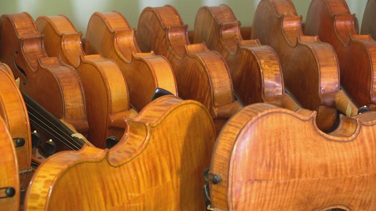 'It's raining violins': Man donates 75 hand-made violins to Muskegon Public Schools