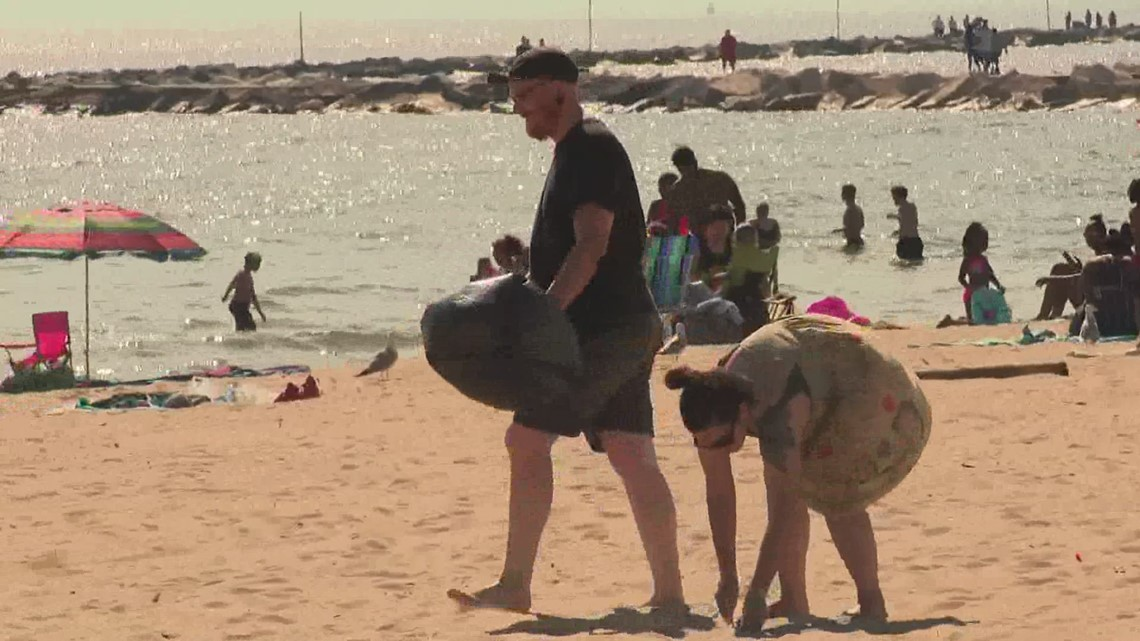Local businesses team up to clean Pere Marquette Beach
