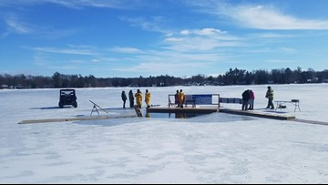 Polar Plunge participants jump into Turk Lake in Greenville