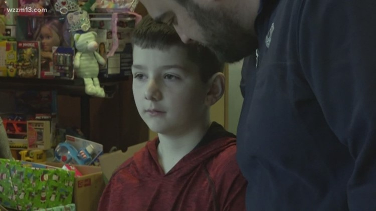 Former cancer patient donate toys to Helen DeVos
