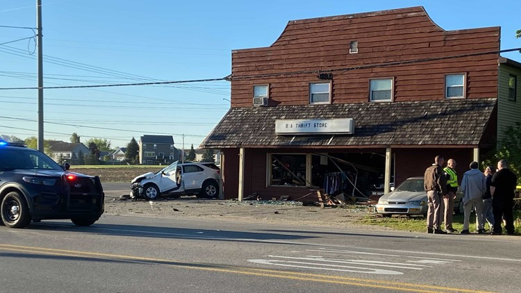 2-vehicle crash ends with truck driving into Hudsonville thrift shop, 3 injured