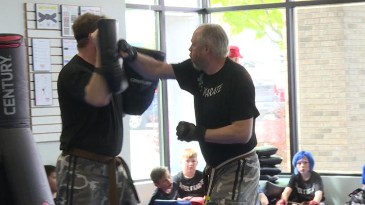 Rockford man with Parkinson's earns black belt