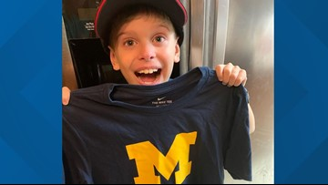 Boy left in tears after receiving gifts, letter from Michigan Marching Band