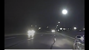 Wyoming police cruiser pushes sleeping, wrong-way driver to safety