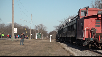 Runners try to outpace a train in Coopersville 5K