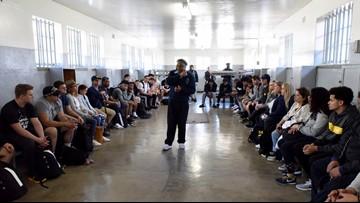 Michigan football team visits prison Mandela spent 18 years
