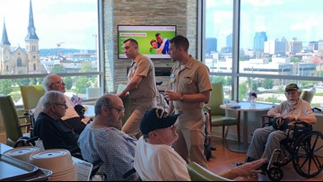 USS Gerald R. Ford sailors visit veteran hospital patients