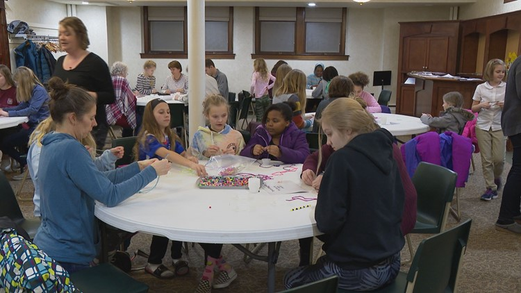 Brynn's church friends help make the bead strands.