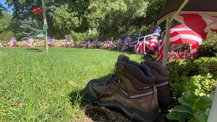'It's sad, but it enhances the display': memorial for 13 fallen service members updated with boots from local business
