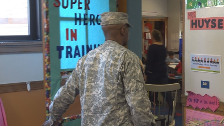SPC Larry Harris was escorted by Stocking Elementary staff to Xzayvier's classroom. Harris walked in and stunned the boy. This was the moment Xzayvier's day-long surprise began.