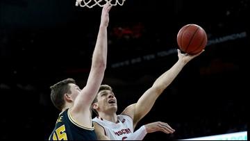 Happ, Wisconsin hand No. 2 Michigan its first loss, 64-54