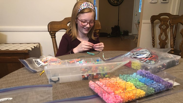 Brynn Van Drie making bead strands.
