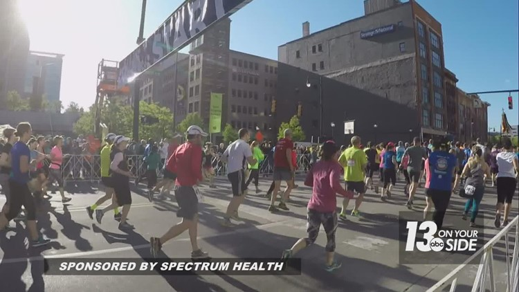 Spectrum Health providers and volunteers work to ensure safety on Amway River Bank Run Course