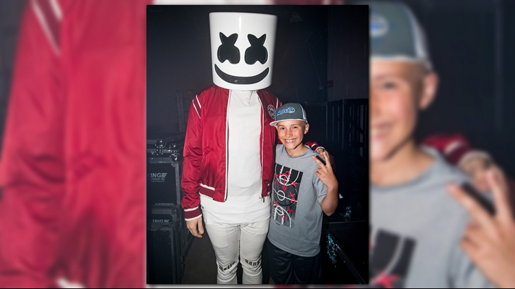 DJ Dill Pickle posing for a photo with DJ Marshmello.