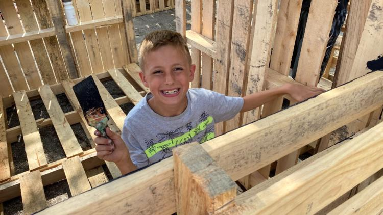 Children's summer camp creates recycled wood forts