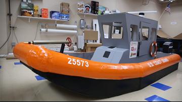 Coast Guard replica boat competing in cardboard boat race