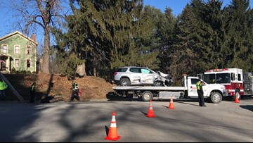 Power pole knocked down in Rockford after garbage truck and car crash
