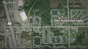 Man rescued from pond after falling into water