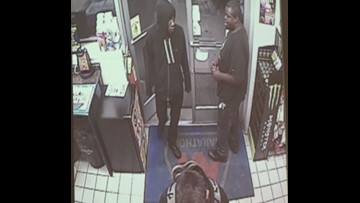 Surveillance video shows gunman shooting gas station clerk