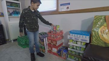 Third grader giving away Thanksgiving dinners