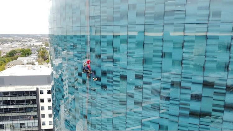 WATCH: Patients wave as Spiderman rappels down Helen DeVos Children's Hospital