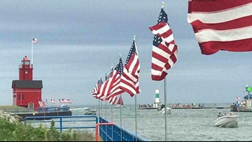 Holland pier lined with American flags for annual Fishing with Veterans event