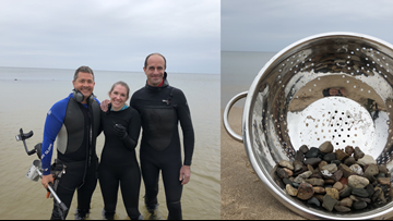 Norton Shores fire chief fishes couple's lost engagement ring out of lake