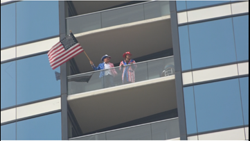 Residents at Grand Rapids condo complex say thank you to health care workers by waving American flag off balconies