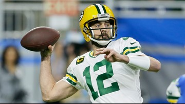 Packers barely beat Lions 23-20 to earn first-round bye