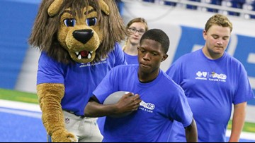Special Olympics Michigan Athletes participate in football camp at Ford Field