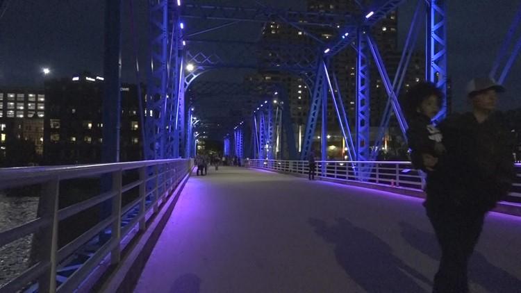 Vigil on Blue Bridge remembers domestic violence victims, offers support for survivors