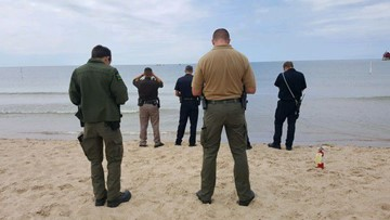 Murder suspect pulled from water at Grand Haven State Park