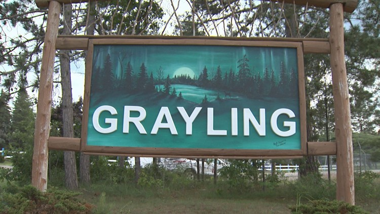 Sign on the road as you enter Grayling, Michigan.