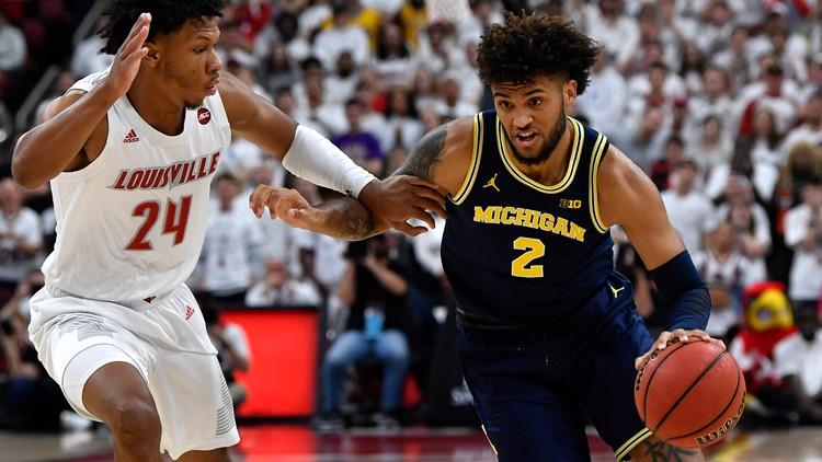 No. 1 Louisville tops No. 4 Michigan 58-43 in Challenge