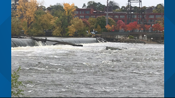 Fishermen rescued from Grand River after boat turns over
