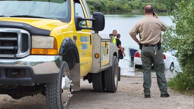 Car, unconscious driver pulled out of water near Gravel Pits in Ottawa County