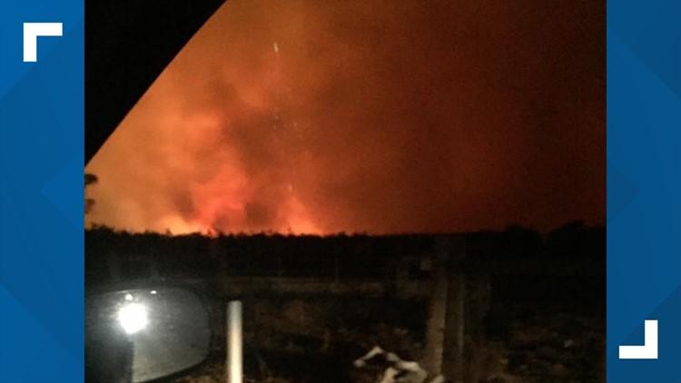 Joe Laub's house burning as he drove away and evacuated.