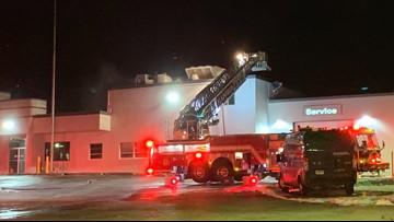 Multiple fire departments extinguish fire at Fox Motors car dealership